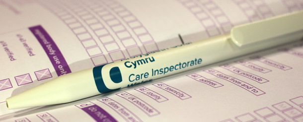 Care Inspectorate Wales pen lying on registration application form